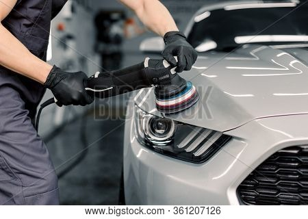 Car Detailing And Polishing Concept. Hands Of Professional Car Service Male Worker, With Orbital Pol