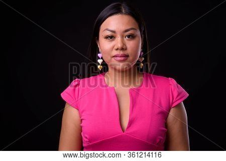 Portrait Of Beautiful Overweight Asian Woman In Pink Dress