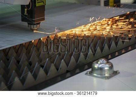 The Fiber Laser Cutting Machine Cutting The Sheet Metal  Plate With The Sparkling Light.  The Hi-tec