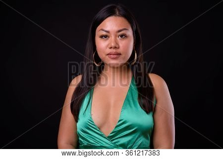 Beautiful Overweight Asian Woman Wearing Silky Green Dress