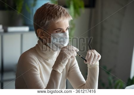 Pensive Woman In Protective Gear Look In Distance Pondering