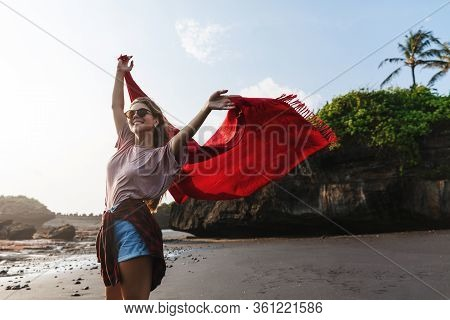 Summer Vacation, Travelling And Relaxation Concept. Carefree Happy Woman Raising Hands Up, Walking A