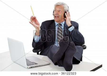 Senior Business Man Imagines Conducting An Orchestra