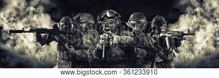 Portrait Of Five Military Men. A Group Of Soldiers On A Background Of Smoke. The Concept Of Military