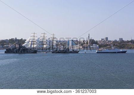 Sevastopol, Crimea, Russia - July 28, 2019: Sailboat Khersones Walks Along The Parade Of Military Sh