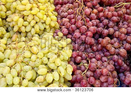 A Bunch Of Fresh Organic White And Red Grapes