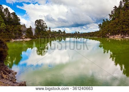 Wai-O-Tapu Geyser Park. Volcanic Valley Waimangu. Crater Lake is a large hot spring and bright green water. New Zealand, North Island. The concept of exotic, ecological and photo tourism