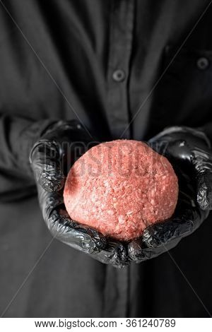 The Minced Meat In The Hands Of A Man With Black Gloves. Prefabricated Patties.