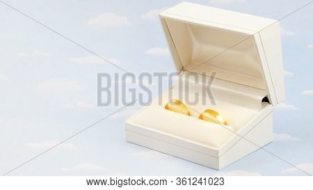 Stock Photo Of A Pair Of Simple Wedding Ring In Yellow Gold In A Box. Photo With Copy Space.