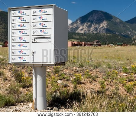 Metal Mailbox Container For Rural Homes With I Voted Stickers As Concept For Voting By Mail Or Absen