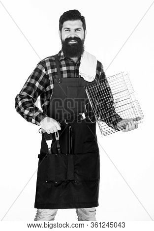 Bearded Hipster Wear Apron For Barbecue. Roasting And Grilling Food. Tips For Cooking Meat. Man Hold