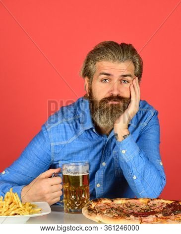 American Fast Food. Bearded Man With Beer And Pizza. Italian Food. French Fries. Guy In Bar Drinking