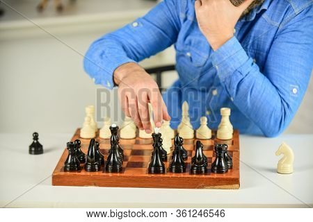 Playing Chess. Intellectual Hobby. Figures On Wooden Chess Board. Thinking About Next Step. Tactics
