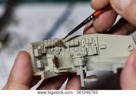 Plastic Modeling And Model Building. Close Up Of Male Hands Painting And Assembling Scale Model Of A