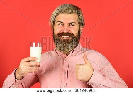 Vegan Milk Concept. Bearded Man Hold Glass Of Milk. Pasteurized Milk. Vegan Milks Made From Wide Var