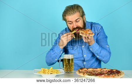 Still Hungry. Beer And Food. Dinner At Pub. Hungry Man Going To Eat Pizza French Fries And Drink Bee