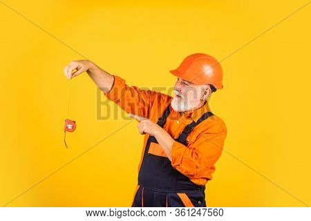 Man At Work. Construction Man Hold Measuring Tape. Engineering And Repair. Happy Carpenter. Handyman