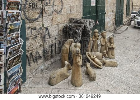 Bethlehem, Palestinian Authority, January 28, 2020:  Figures Carved From An Olive Tree On The Street