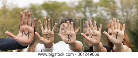 Word Merci Written On Child Hands, Panoramic View