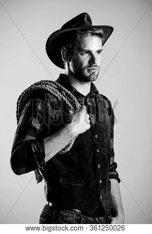 Man Wearing Hat Hold Rope. Ranch Occupations. Lasso Tool Of American Cowboy. Lasso Is Used In Rodeos