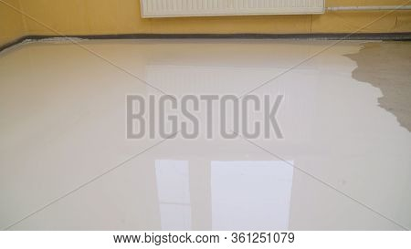 Floor Leveling. Filling The Floor With A Self-leveling Compound. Self-filling Floor