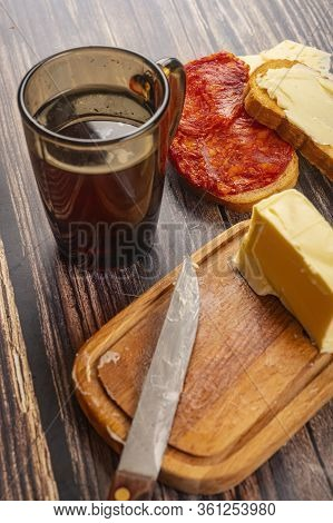 Fresh Wheat Toast With Butter, Cheese And Sausage, A Piece Of Butter In A Wooden Butter Dish And A M