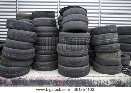 Old Used Tires Stacked. Black Piles Of Used Tires.