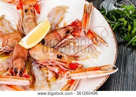 Seafood. Langoustine, Scampi Or Norway Lobster With Lemon On White Plate.