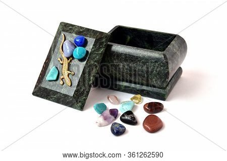Malachite Box And A Scattering Of Multi-colored Stones On A White Background
