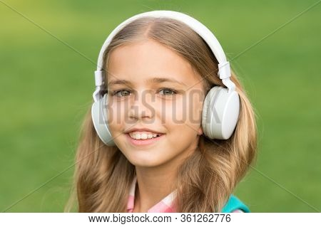 Never Stop E-learning. Happy Kid Listen To E-learning Course. Small Girl Study Online. E-learning In