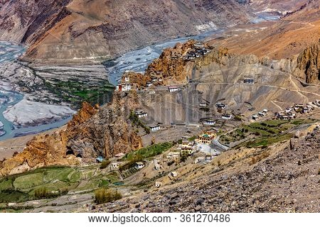 Dhankar monastry perched on a cliff in Himalayas and village. Dhankar, Spiti Valley, Himachal Pradesh, India