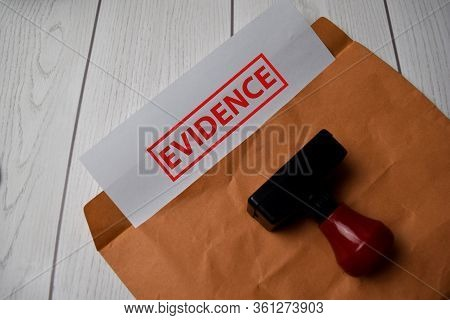 Evidence Text On Document Above Brown Isolated On Office Desk