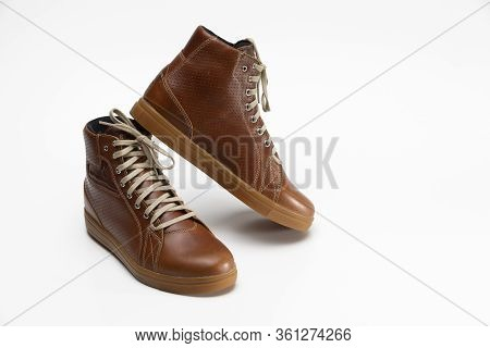 Closeup Of Motorcyclist Tan Leather Protective Boots. Against White Background.