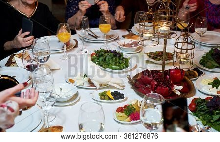 Group Of People Dining Concept. Table With Food And Friends