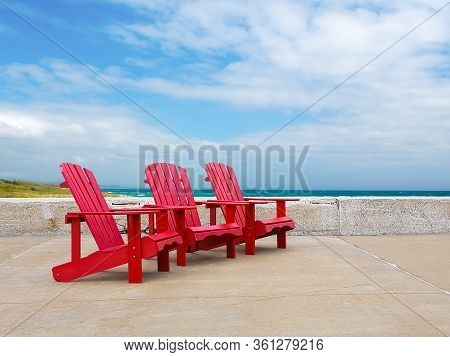 Traditional Adirondack Chairs With A Beautiful Background
