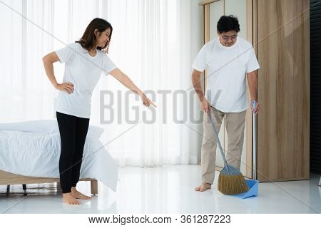 Asian Senior Couple Cleaning Bedroom Floor.