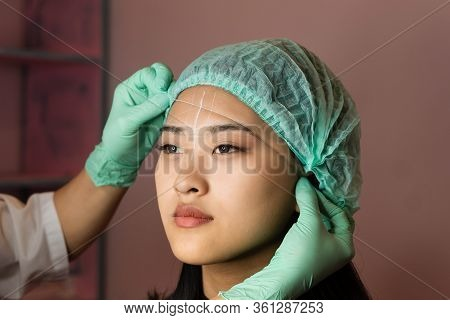 Microbleeding And Eyebrow Architecture. Beautician Builds Lines Of Symmetry Eyebrows On Girls Face.