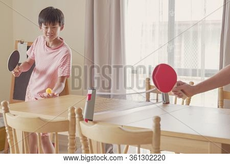 Healthy Mixed Asian Preteen Boy Playing Table Tennis On Dining Table At Home, Tween Exercise, Child