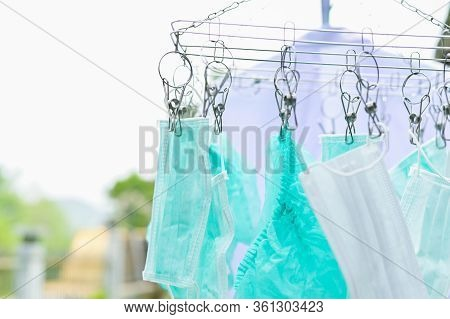 Medical Mask Hanging On Clothesline , Wash With Soap Sterilized By Sun Reuse Mask For Protection Dis