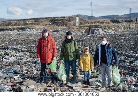 Group Of Activists Standing On Landfill, Environmental Pollution Concept.