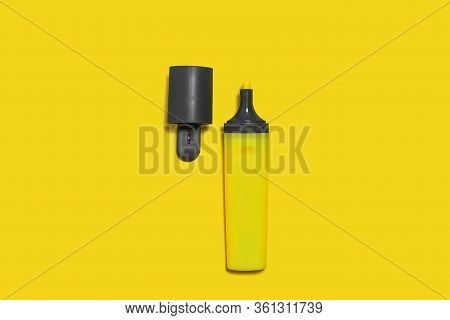 New Yellow Bright Plastic Marker Lying On A Yellow Background With An Opened Cap. Concept Of Office