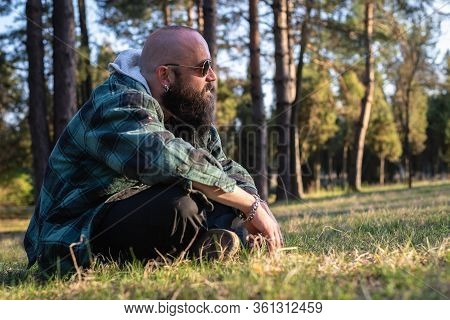 Man In Nature In Sunset. People In Nature.. Man Hipster Relaxing In Nature In Sunset. Beautiful Peop