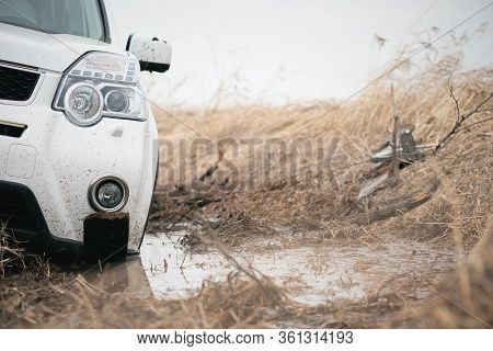Suv Stuck In A Swamp Close Up.