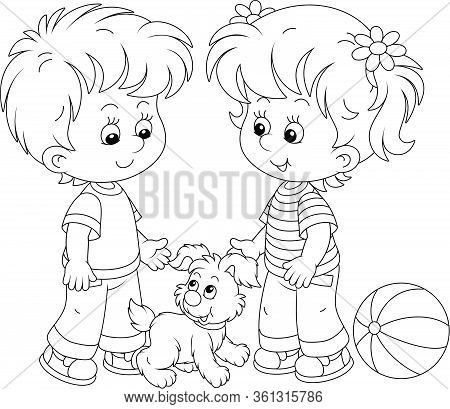 Smiling Little Children Talking And Walking Together With A Cheerful Grey Puppy, Black And White Out