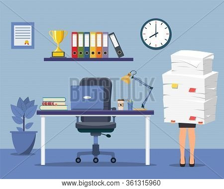 Office Interior With Desk, Chair, Computer. Stressed Businesswoman Holds Pile Of Office Papers And D