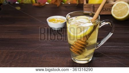 Autumn Hot Tea Warming Drink With Ginger, Honey And Lemon In Glass On Wooden Background. Copy Space.