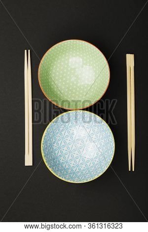 Dishes For Asian Food On Black Background. Top View. Food Background