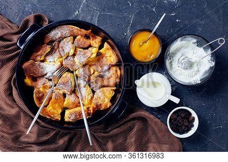 Austrian Sweet Pancake Kaiserschmarrn With Applesauce, Raisins And Powdered Sugar, Golden Cutlery On