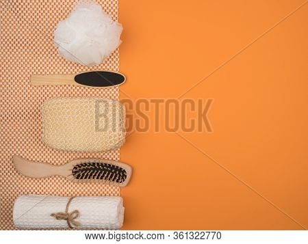 Items For Body Care In The Bathroom On An Orange Background. The View From The Top.