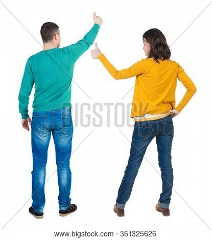 Back view of couple in sweater showing thumbs up. beautiful woman and man together. Rear view people collection. backside view of person. Isolated over white background.